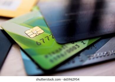 Stack of credit cards with selective focus, close up view. Heap of plastic cards with chip, macro.