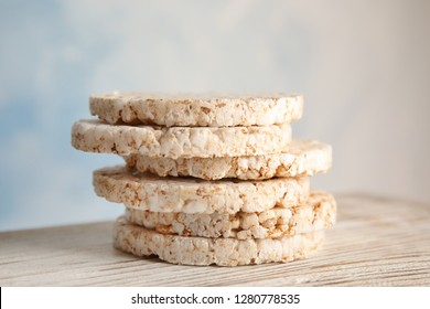 Stack of crunchy rice cakes on wooden table