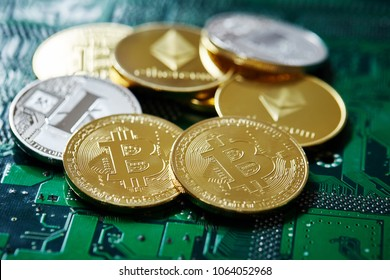 Stack of cryptocurrencies in a circle on motherboard. Cryptocurrency concept, close-up, selective focus