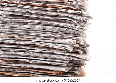 stack of daily newspapers background