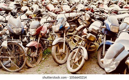 Stack of damaged motorbikes isolated unique stock photograph