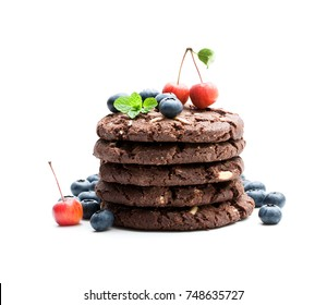stack  of dark chocolate cookies with fresh blueberry and wild apples isolated on white background