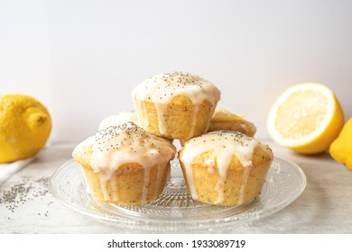 A stack of delicious homemade lemon poppy seed muffins on bright background.