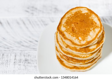 stack of delicious pancakes on a plate, top view closeup
