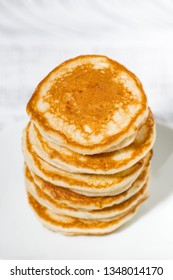 stack of delicious pancakes on a plate, top view