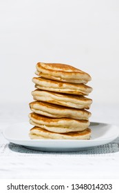 stack of delicious pancakes on a plate, vertical closeup