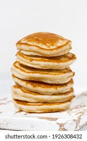 stack of delicious pancakes on a white background, closeup