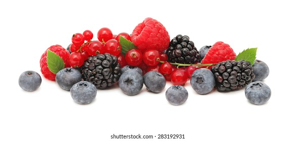 Stack of different berries (blueberry, raspberry, redcurrant and blackberry) with green leaves isolated on white background