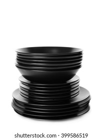 Stack of different black ceramic plates, isolated on white