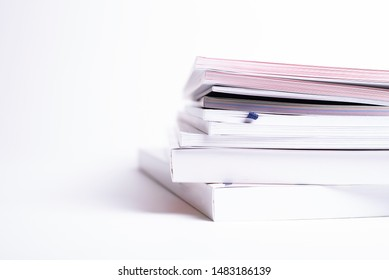 stack of different broshures and books isolated on a white background