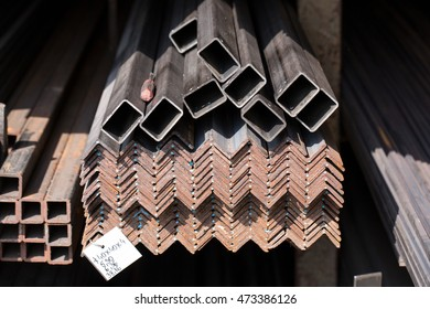 Stack of different iron bars and stainless steel profiles