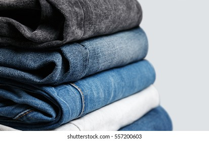 Stack of different jeans up-close. Low aperture shot, selective focus