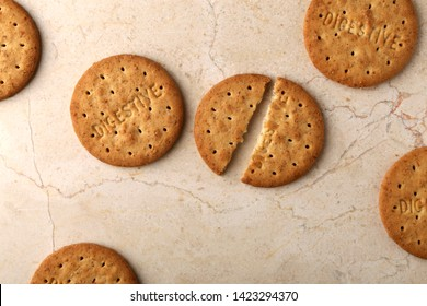 Stack of digestive biscuits closeup of a pile of biscuits on a texture background
