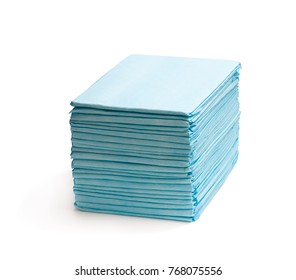 Stack  of disposable bed pads isolated on white