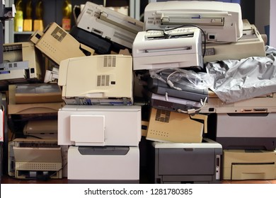 Stack of disused computer printers to be scrapped or recycled.