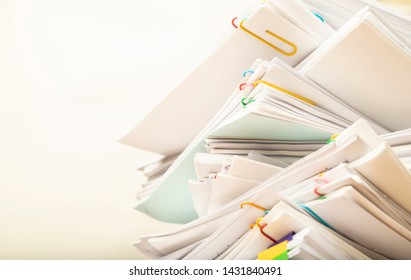 Stack of document paper with colorful paperclip with copy space, business concept paperless used and work overload.
