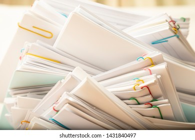 Stack of document paper with colorful paperclip, business concept paperless used and work overload.
