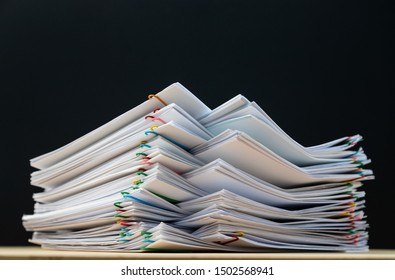 Stack of document paper with colorful paperclip place on wooden table and copy space, business concept footage paperless used