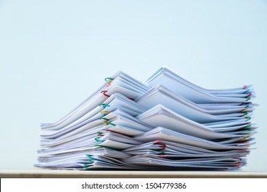 Stack of document paper with colorful paperclip place on wooden table with copy space, business concept footage paperless used