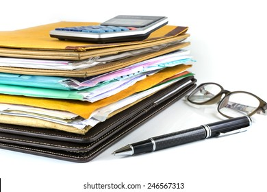 Stack of document with pen and calculator on white