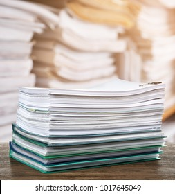 Stack of documents on table in archive