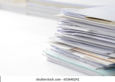 Stack of documents on white table with copy space for text,high key tone.