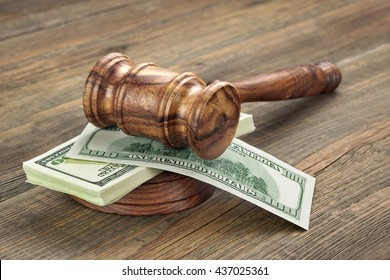 Stack Of Dollar Banknotes With Judges Or Auctioneers Gavel Or Hammer, Trial Or Tribunal Concept, Auction Concept, Close Up