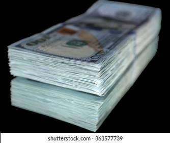 Stack of dollar banknotes on black background