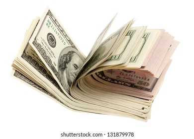 A stack of dollar bills fanned out on a white background
