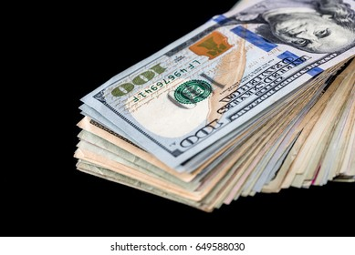 stack of dollar isolated on black. close up