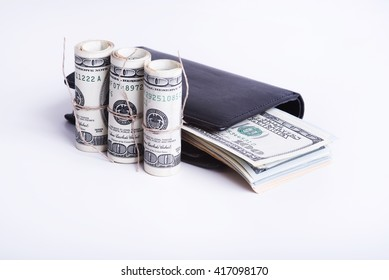 Stack of dollars in a black wallet