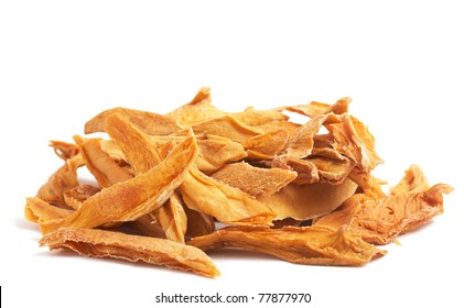 Stack of dried mango slices isolated on white background