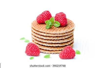 Stack  of Dutch caramel waffles with fresh raspberry and cup of milk