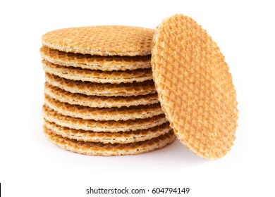 Stack of Dutch stroopwafel cookies or caramel waffles isolated on white.