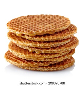 Stack of dutch waffles with caramel isolated on white background
