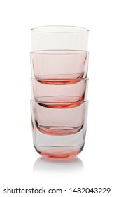 Stack of empty colorful whiskey glasses on white background