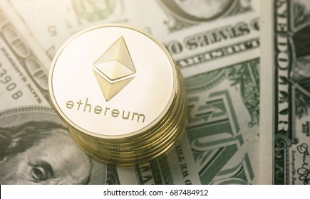 Stack of ethereum coins on dollar notes