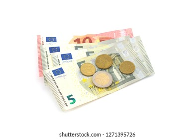 Stack of Euro banknotes and coins isolated