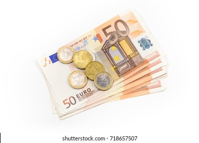 Stack of Euro banknotes and coins isolated. 50 Euro banknotes. European currency money banknotes isolated on white backdrop. Top view closeup. Salary, savings, european union economic crisis concept.