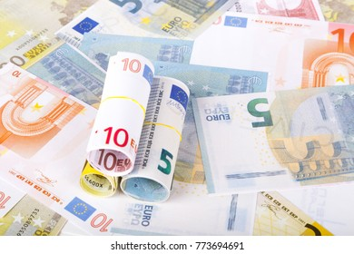 Stack of Euro banknotes with money consuming and finance, on full background.