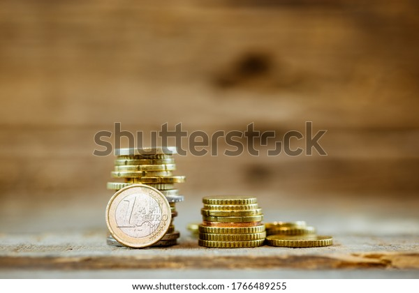 Stack of euro coins on a rustic wooden table