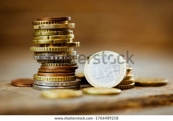 Stack of euro coins on a wooden table