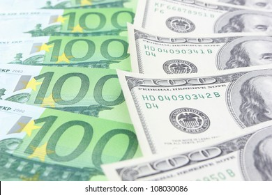 Stack of euro and dollar banknotes
