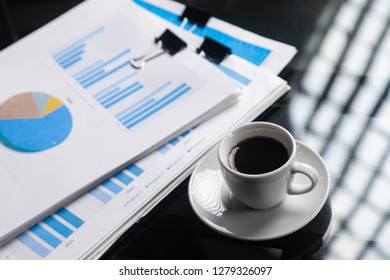 stack of financial documents and a Cup of coffee close-up