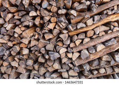 Stack of fire wood for background texture in winter