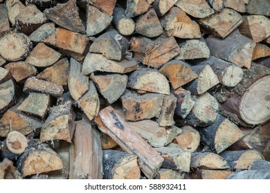 Stack of firewood background. Pile of chopped fire wood