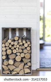 Stack of firewood in modern house