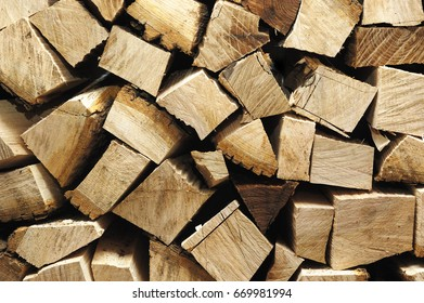 Stack of firewood, nature background.