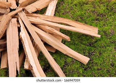 Stack of firewood on grass close up