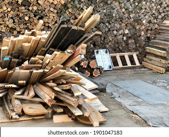 Stack of firewood prepare at outside of local Japanese public bath. Old and dilapidated of Japanese tradition public bath house atmosphere.